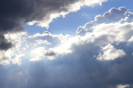 Sun ray piercing through some clouds Stock Photo