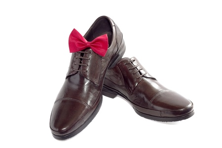 Concept of a fashion for the man - shoes and bow tie on white Stock Photo - 14533990