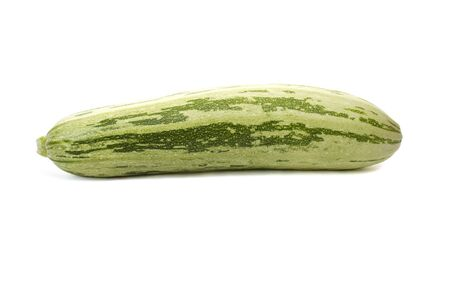 green zucchini with long strips on  white Stock Photo