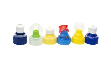 colorful plastic bottle caps isolated on white background