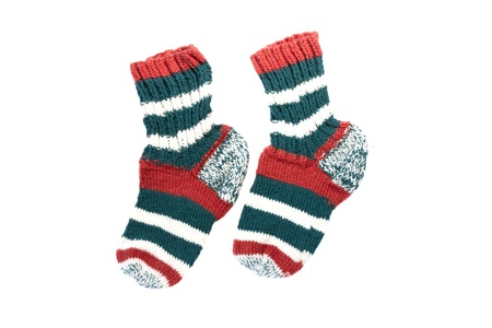 Two multi-colored knitted sock isolated on white background