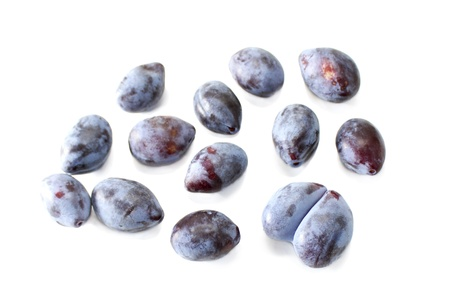Some plums  isolated on white