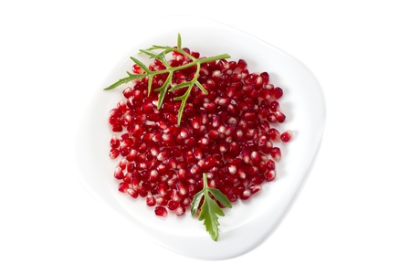 Pomegranate seed pile and green leaves