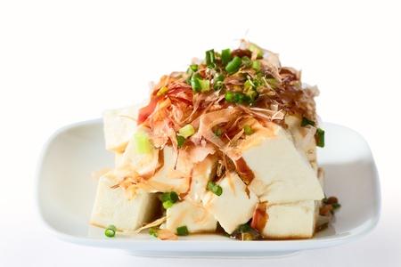Tofu topped with bonito flakes. Stock Photo