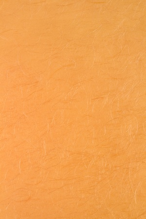 Textured Japanese gold-colored paper for background. photo