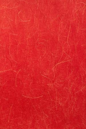 Papel japonés de color rojo con hilos de oro.