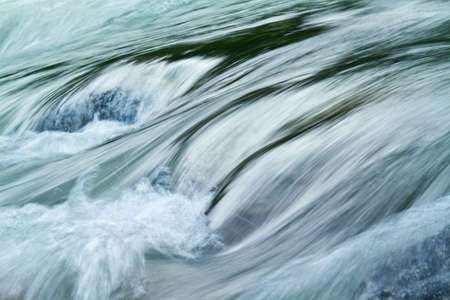 Rapid stream of a mountain river   Stock Photo