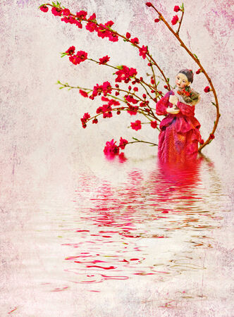 Doll and plum branches reflected in the water   Stock Photo