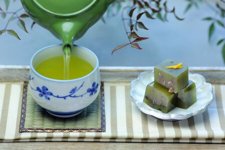 A cup of Japanese green tea and Japanese sweets yokan.