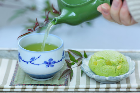 A cup of Japanese green tea and Japanese sweets.