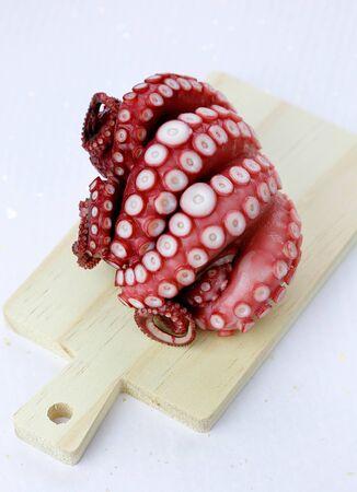 Octopus on cutting board. Stock Photo