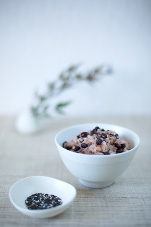 Sekihan - rice steamed with azuki beans and black sesame. place for text, shallow DOF