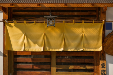 Noren curtains at the entrance to a Japanese restaurant. Editorial
