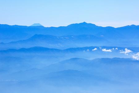 Mountain Fuji and high mountain range at Nagano prefecture, Southern Japan Alps.