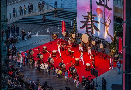 TOKYO, JAPAN - JANUARY 01, 2018: The performance of an unknown group of Japanese drummers wadaiko on Roppongi Hills stage in Tokyo during the New Year holidays. Editorial