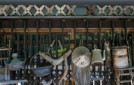 Old utensils as decoration on the wall of Japanese house / restaurant. Editorial