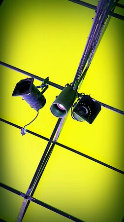 shadowed: Celling lights with bright green shadowed background