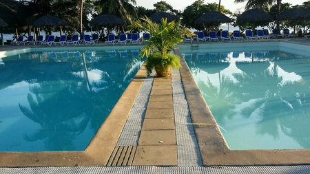 Still blue water in tropical resort swimming pool