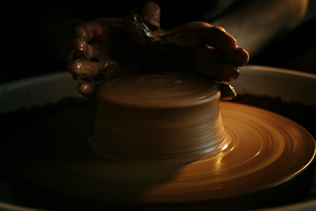 The art of pottery, creating a jug out of clay Stock Photo