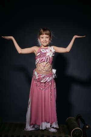 A little girl dressed as an belly dancer Standard-Bild