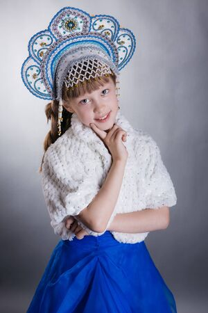 A little girl dressed as Snow Maiden
