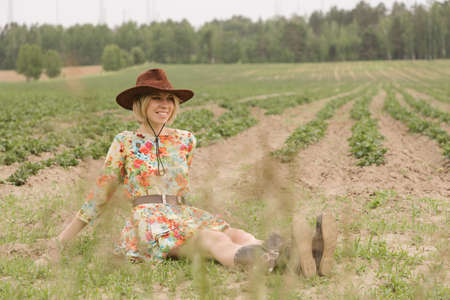 Cowboy girl in the field
