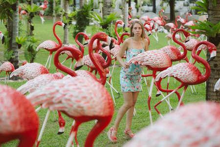 Beautiful girl in a tropical Asian garden Standard-Bild