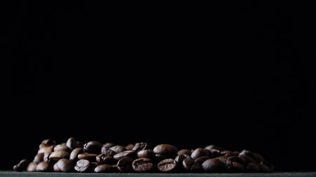 coffee beans spin on a dark background