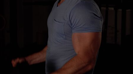 muscular guy lifts a dumbbell