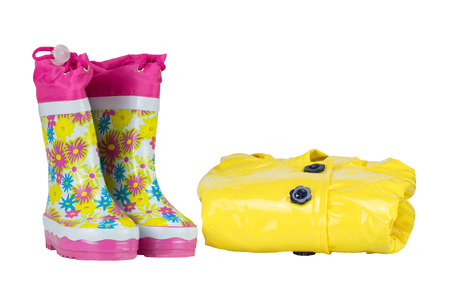 Rubber boots and elegance yellow jacket for girl. white isolated.