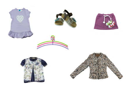 Collage of children clothes. Concept spring and summer clothes. Isolated on white. Close up.