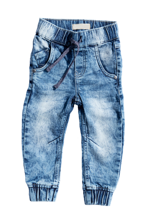 Blue jeans trouser isolated on white background. Fashionable jeans for child boy. Top view front.