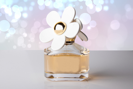 Luxurious perfume in a beautiful bottle with white flowers on luxurious perfume in a beautiful bottle with white flowers on white background with pink bokeh background mightylinksfo