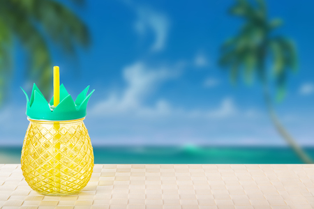 Drinking a fresh ananas juice from ananas glasses at he tropical beach. Summer holiday concept.