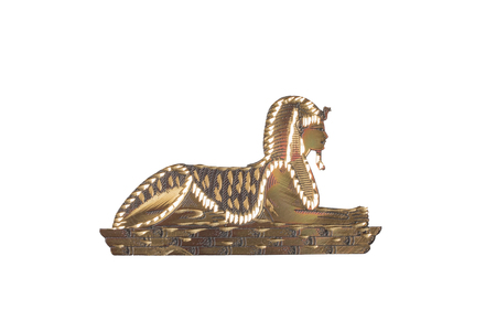 Egyptian Sphinx. Golden egyptian sphinx from metalic material isolated on a white background.