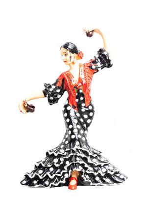 Spanish flamenco dancer. Close-up of woman dancing flamenco in traditional costume. Ceramic figure.