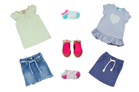 Summer fashion. Collage set of baby child girl clothes isolated on a white background. T-shirts, skirts, shoes and socks.