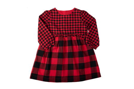 Clothes for children. A beautiful red and black checkered girl dress isolated on a white background. Children fashion.