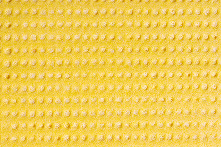 Cleaning cloth. Closeup of bright yellow viskose cleaning rag. Pattern yellow background or backdrop. Macro. 免版税图像 - 115819830