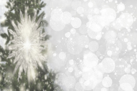Abstract christmas tree bokeh background. Abstract blurred festive winter xmas backdrop texture with shiny silver and white bokeh snow lights. Space. Card concept.