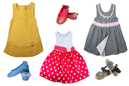 Top view on child girl set of clothes. Collage of apparel clothing. Skirts and sneaker or shoes isolated on a white background. Summer fashion.