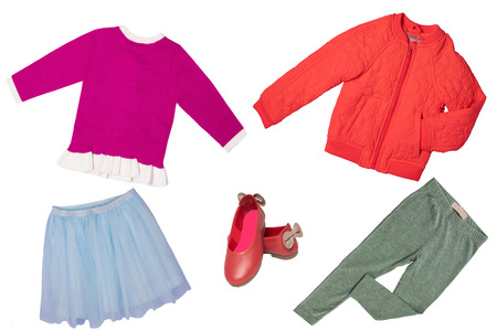 Top view on child girl set of clothes. Collage of apparel clothing. Skirts, sneaker, jacket, shirt and trousers isolated on a white background. Summer fashion.