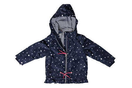 Kids jacket isolated. A stylish fashionable dark blue jacket with white dots and blue white striped lining for the little girl. A rain coat and windbreaker with hood for spring and autumn.