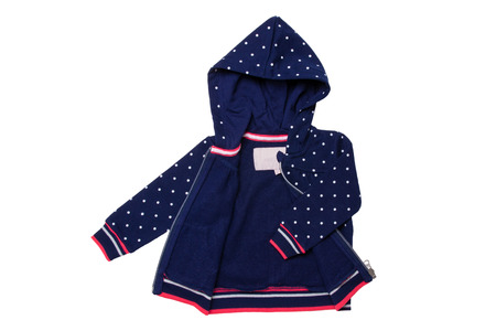 Kids jacket isolated. A stylish fashionable dark blue jacket with white dots and blue lining for the little girl. A sport jacket with hood for jogging isolated on white. Children sport fashion. Imagens