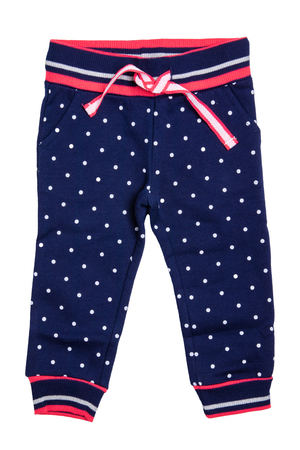 Kids pants isolated. A stylish fashionable dark blue denim trousers with white dots for the little girl. Children sport trousers.