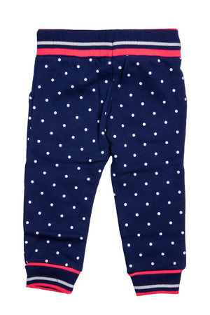 Kids pants isolated. A stylish fashionable dark blue denim trousers with white dots for the little girl. Children sport trousers. Back view.