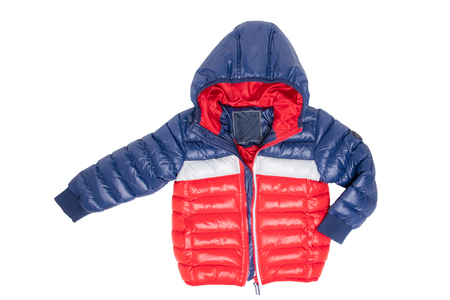 Winter jacket isolated. A stylish blue and red warm down jacket with red lining for the kids is isolated on a white background. Childrens wear with hood for spring and autumn.