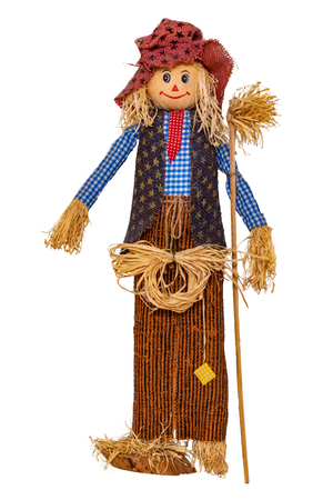 Straw decorations background. Close-up of a funny handmade scarecrow doll isolated on white background. Straw dolls for thanksgiving in autumn. Macro. Stock Photo