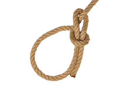 Rope isolated. Closeup of figure Palstek sailors knot or node from a brown rope isolated on a white background. Navy and marine knot or sailors knot. Macro.