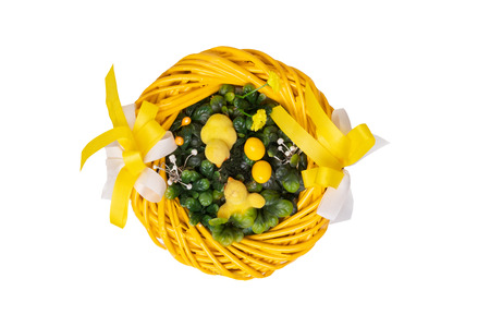 Easter decorations background. Closeup of a yellow Easter wreath with yellow little easter chicks isolated on a white background.